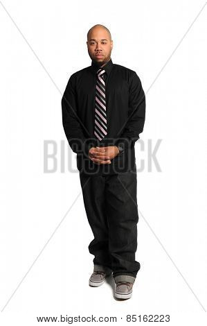 Portrait of young African American businessman standing isolated over white background