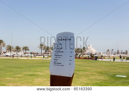 DOHA, QATAR - MARCH 8, 2015: Direction sign in Arabic and English in the recently opened Souq Waqif park