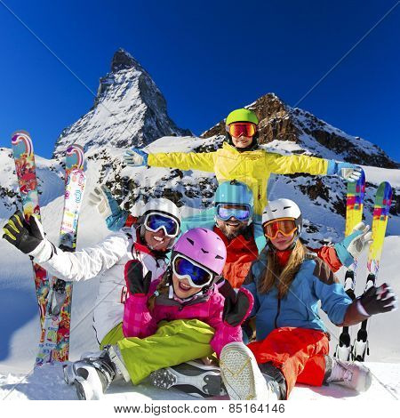 Ski, winter, snow - family enjoying winter vacation in Zermatt, photo manipulation: Only four model releases are needed - the same child on the photo.