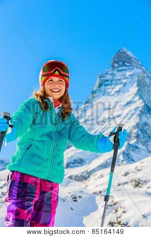 Young skier with view of Matterhorn on a clear sunny day, Zermatt, Switzerland