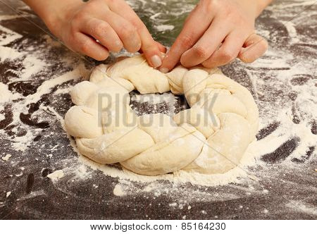 Making pie by female hands on wooden table background