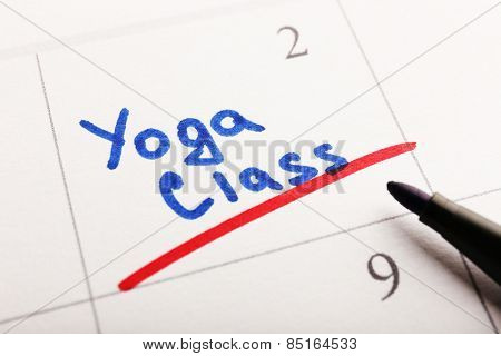 Written plan Yoga Class on calendar page background
