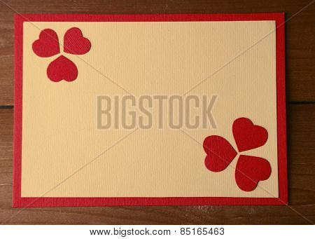 Beautiful hand made post card on wooden background