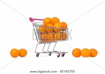 Supermarket trolley full of oranges isolated on white