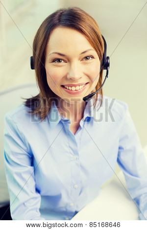business, communication and call center concept - female helpline operator with headphones
