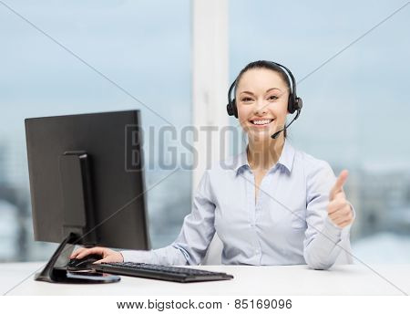business, communication and call center concept - friendly female helpline operator with headphones showing thumbs up