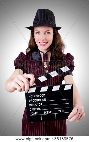 Woman gangster with movie board
