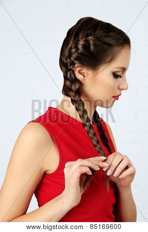 Female hairstyle on light background