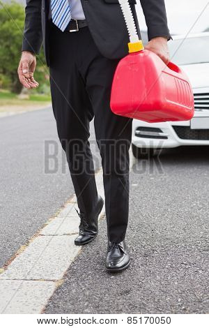 Man bringing petrol canister after broken down on the road