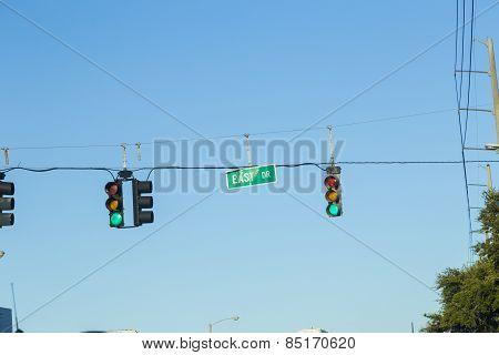 green traffic lights under clear blue sky