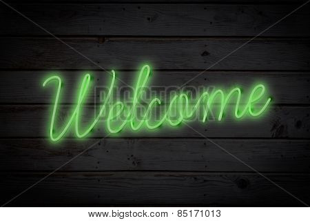 welcome sign against black wood