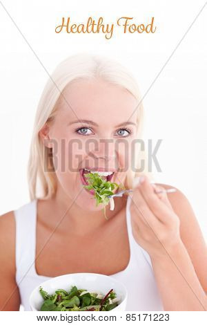 The word healthy food against gorgeous woman eating salad