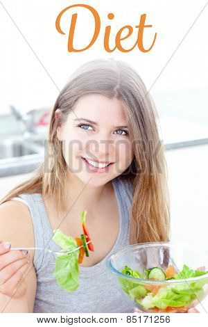 The word diet against smilling woman eating salad in the kitchen