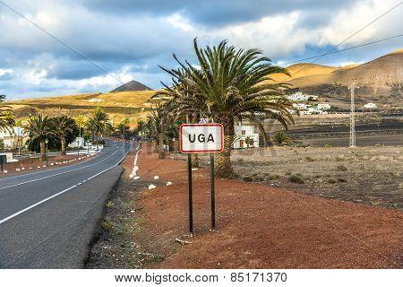 Street Sign Of Village Of Uga In Evening Light
