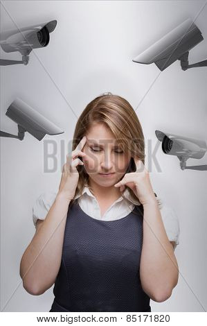 Businesswoman with headache against cctv camera