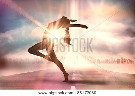 Side view of a sporty young woman stretching against city on the horizon with light beam