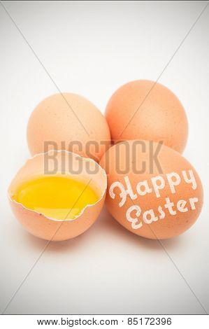 happy easter against three eggs with raw yolk in half a shell