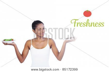 The word freshness against pretty woman deciding to eat healthily or not