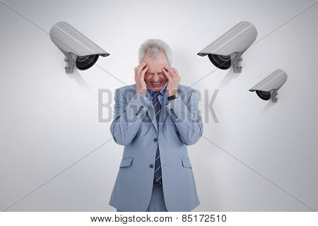 Man with headache against cctv camera