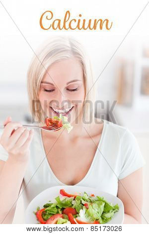 The word calcium against blonde woman eating salad