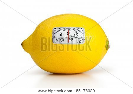 weighing scales against yellow lemon