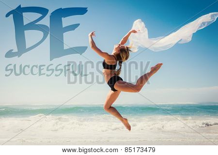 Fit blonde jumping gracefully with scarf on the beach against be sucessful