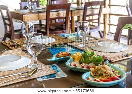 table setup in outdoor cafe, small restaurant in a hotel, summer vacations, meal time