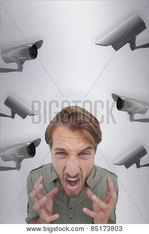 Overhead angle of frustrated man against cctv camera