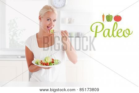 The word paleo against blonde woman eating a salad