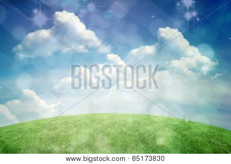 Light design shimmering on green against green field under blue sky
