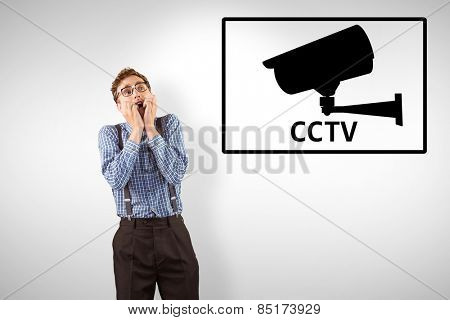 Geeky hipster biting his nails against cctv
