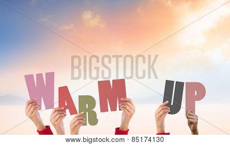 Hands holding up warm up against desert landscape
