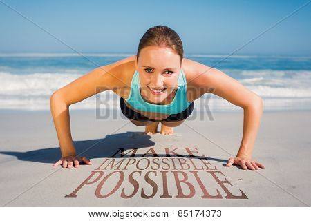 Fit woman in plank position on the beach against make impossible possible