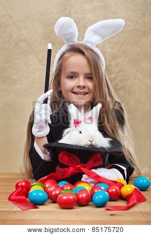 Conjuring the easter rabbit - young magician perform a seasonal trick