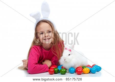Happy girl with her easter rabbit and colorful dyed eggs - isolated