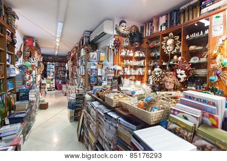 DUBROVNIK, CROATIA - MAY 28, 2014: Sales woman sitting behind the counter in the book store.