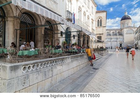 DUBROVNIK, CROATIA - MAY 28, 2014: Guests sitting at terrace of Gradska kavana, famous coffee location in the old town.
