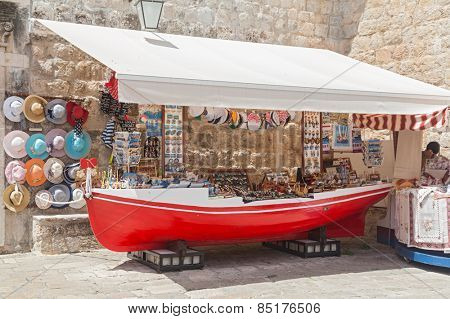 DUBROVNIK, CROATIA - MAY 27, 2014: Souvenir street stand shaped as old red boat.