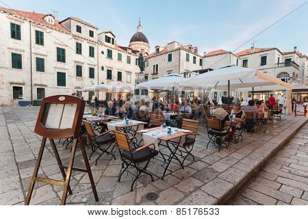 DUBROVNIK, CROATIA - MAY 28, 2014: People sitting at the restaurant's terrace. Dubrovnik has many restaurants which offer traditional Dalmatian cuisine and some great wine lists.