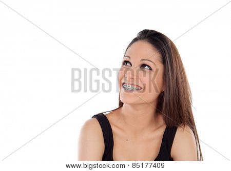 Smiling cool girl with brackets looking up isolated on a white background