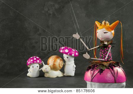 ceramic puppets handmade, gray background