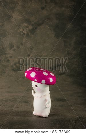 cute puppet handmade, one mushroom, gray background
