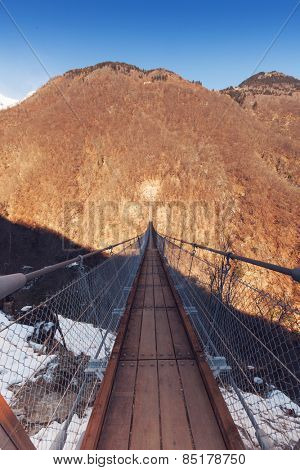 Mountain landscape with suspension bridge over the valley