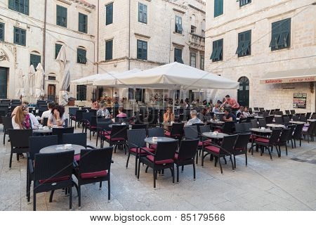 DUBROVNIK, CROATIA - MAY 28, 2014: Guests sitting at restaurant terrace. Dubrovnik has many restaurants which offer traditional Dalmatian cuisine and some great wine lists.