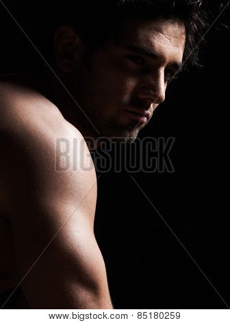 handsome  sexy topless macho man portrait topless muscular in studio black background