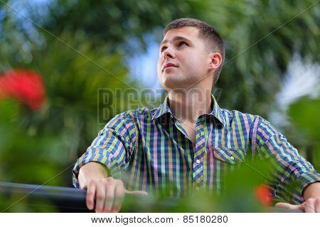 Handsome man in a garden