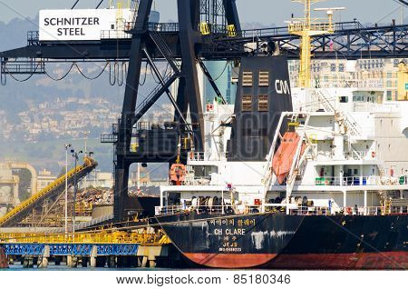 Alameda, CA - March 9, 2015: Oakland Shipyard, Schnitzer Steel exportation of steel scrap to China
