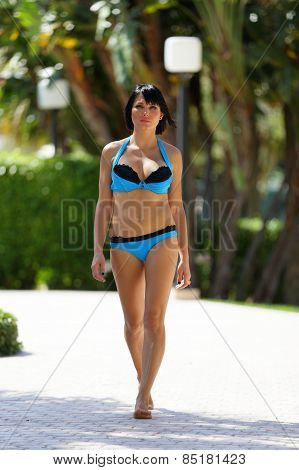Bikini model approaching the camera