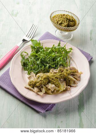 stewed meat with pesto sauce and arugula salad