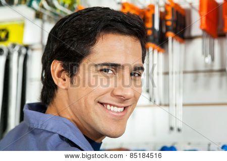 Closeup portrait of handsome man smiling in hardware shop